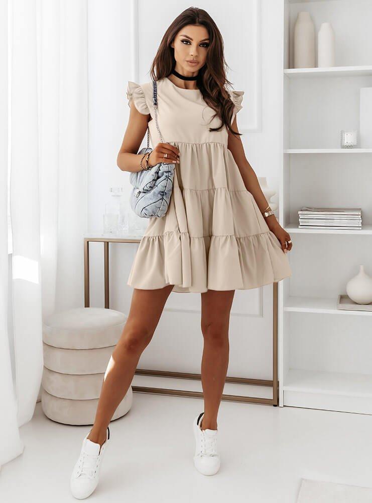 Jasnobeżowa sukienka z falbankami przy rękawie Eliissa