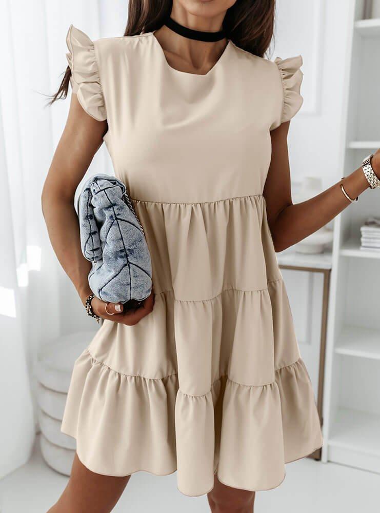 Jasnobeżowa sukienka z falbankami...