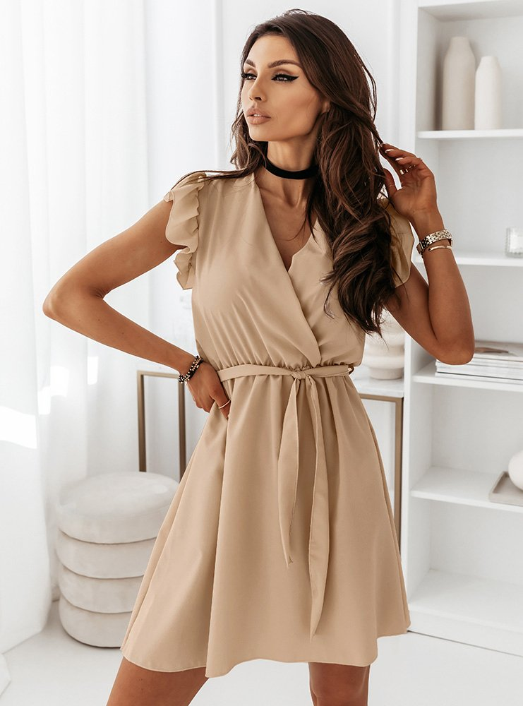 Jasnobeżowa sukienka z przekładanym...