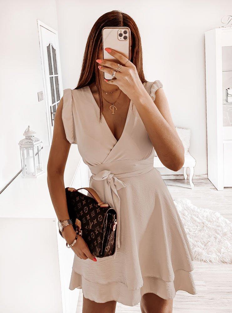 Beżowa sukienka z przekładaną górą i falbankami Lailie