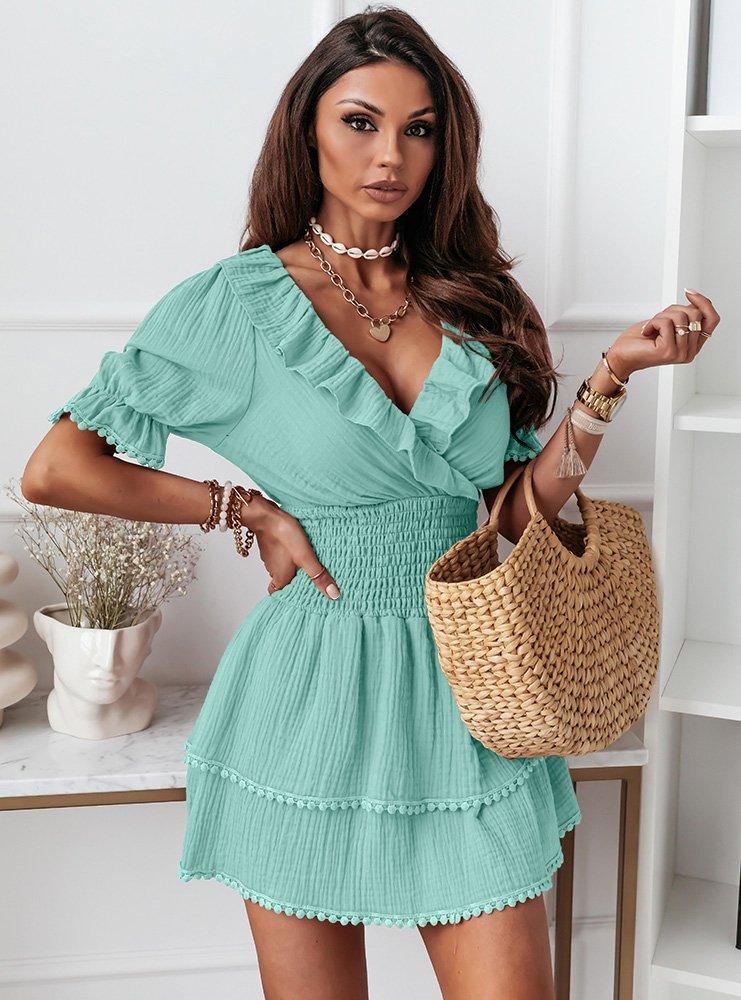 Miętowa sukienka z falbankami Rizalla