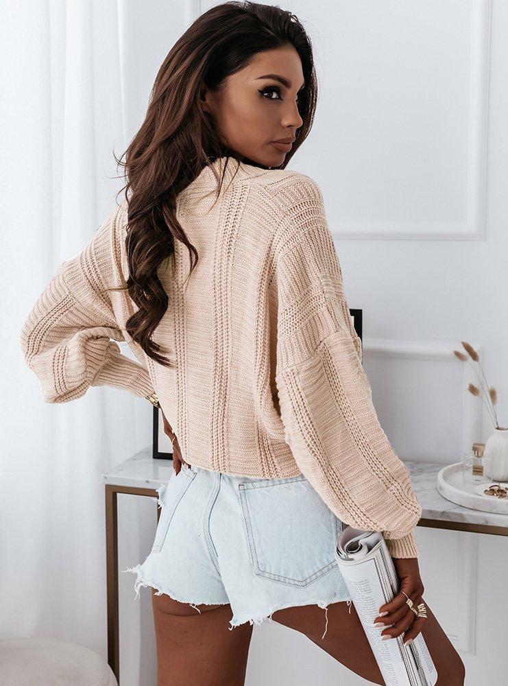 Beżowy sweter z ozdobnym splotem i...