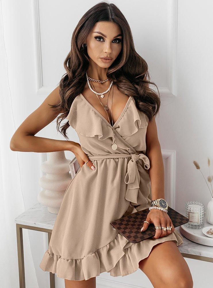 Jasnobeżowa sukienka z falbaną przy...