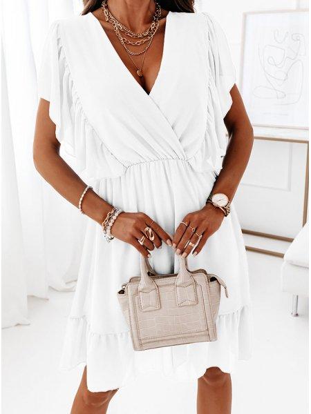 Biała przekładana sukienka...