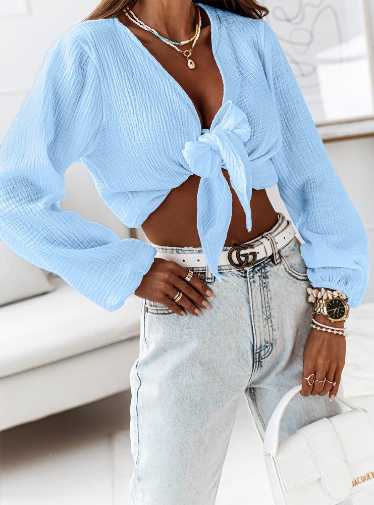 Błękitna muślinowa bluzka wiązana...