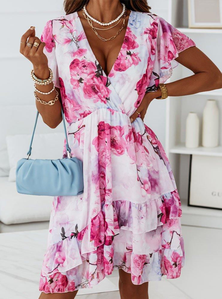 Wzorzysta sukienka z falbankami...