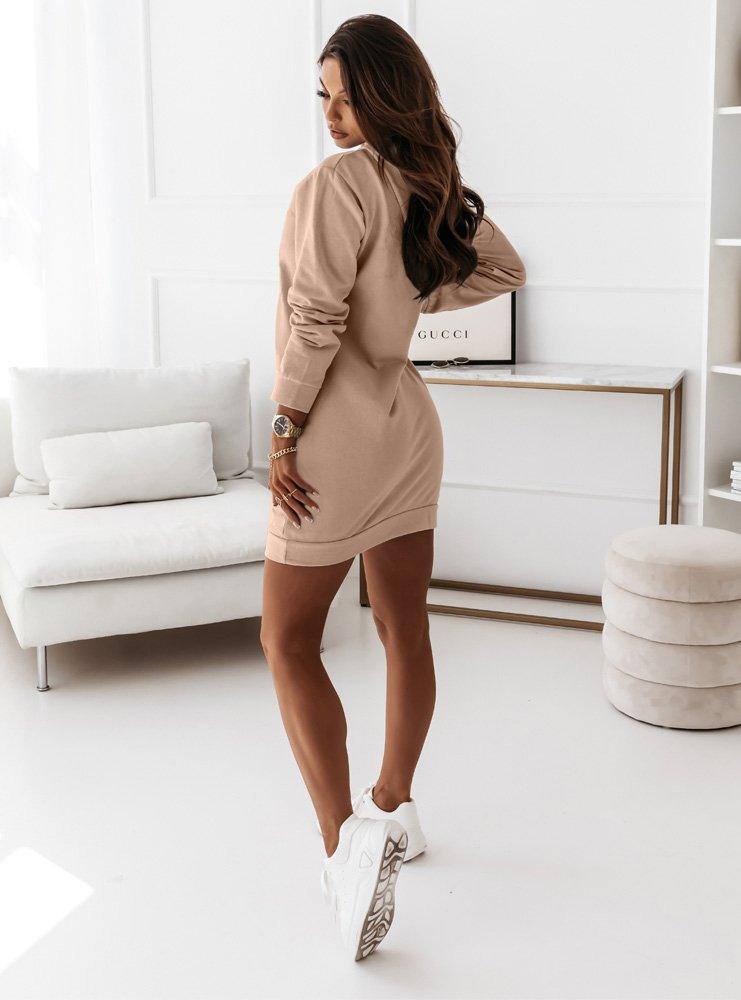Beżowa sukienka sportowa z nadrukiem...