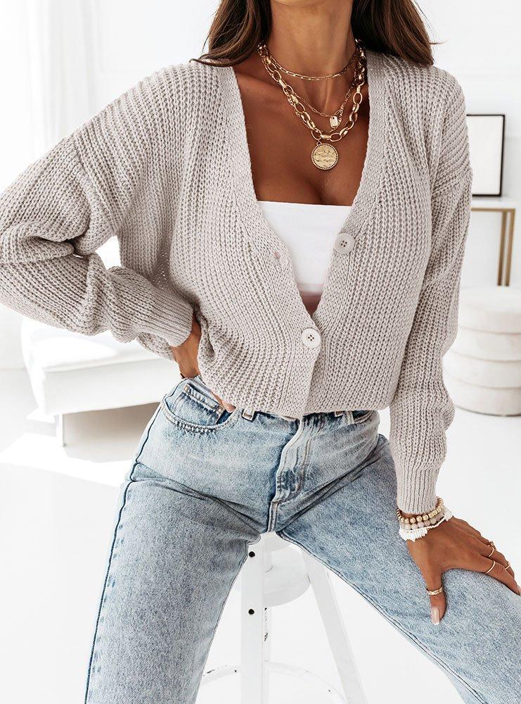 Beżowy sweterek zapinany na guziki...