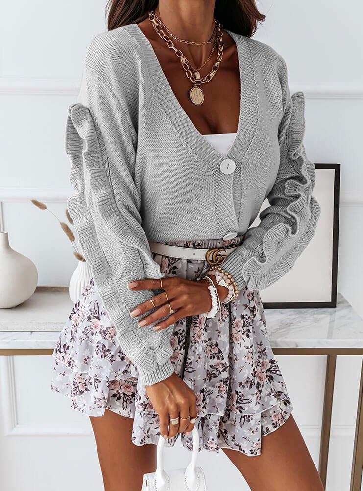 Szary sweter zapinany z falbanką na rękawie Rominaa