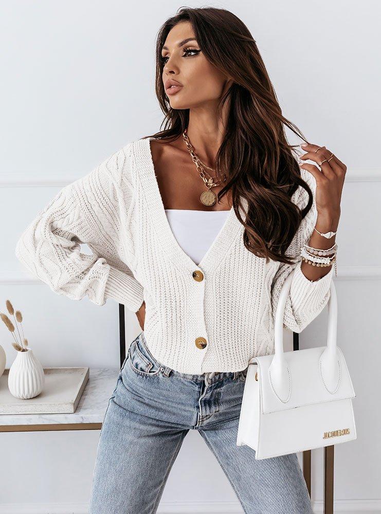 Biały sweterek zapinany na guziki...