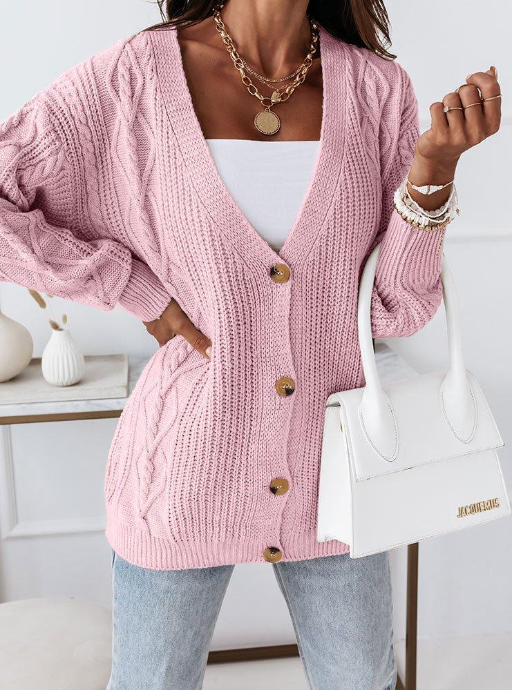 Pudrowy sweterek zapinany na guziki...