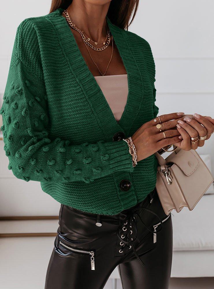 Sweter z guzikami i ozdobnymi...