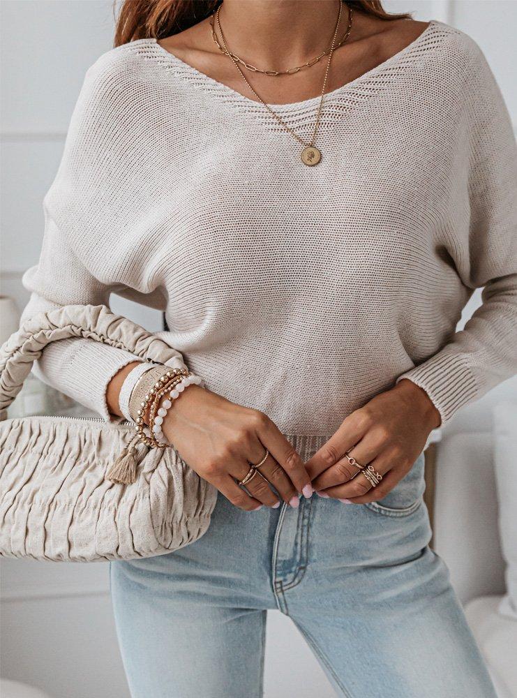 Beżowy sweterek z ozdobnym wiązaniem...