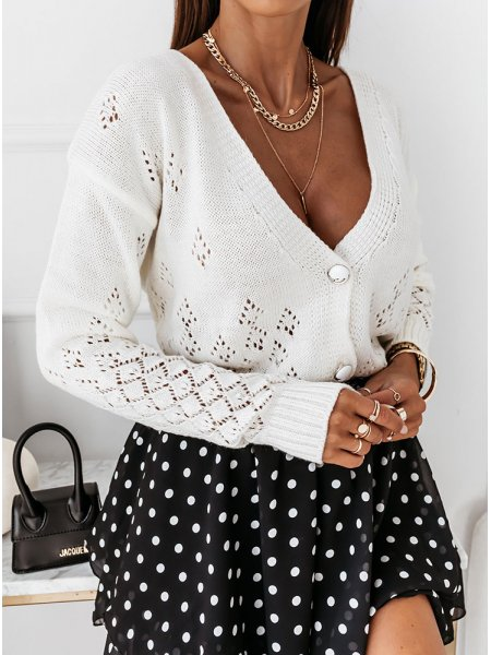Sweterek z ozdobnymi...