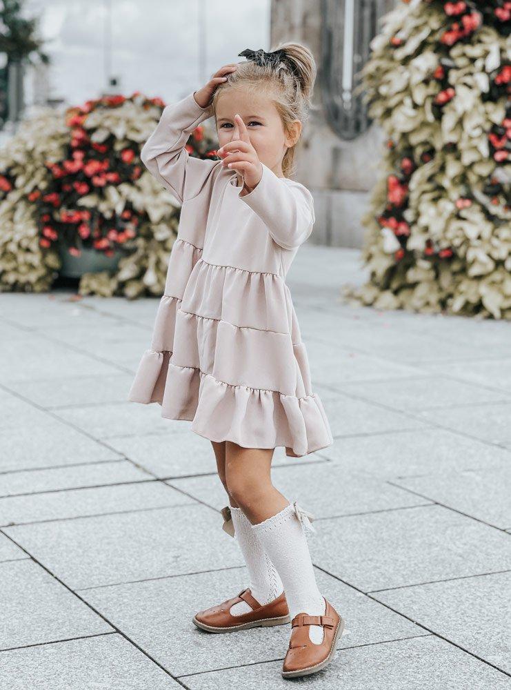 Beżowa dziewczęca trapezowa sukienka...