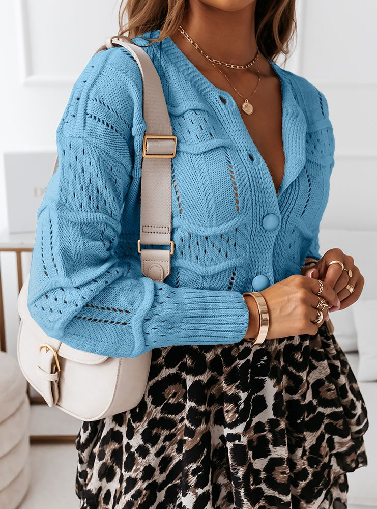 Błękitny ażurkowy sweter zapinany na...