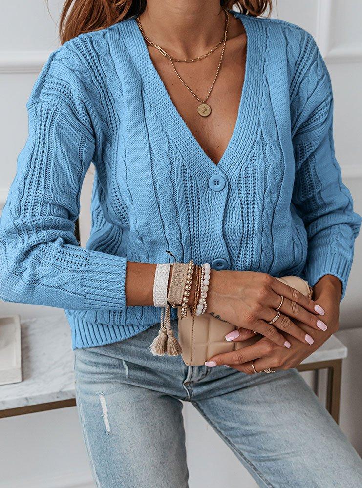 Błękitny sweter z ozdobnymi...