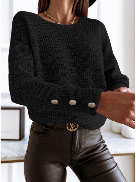 Czarny sweterek z ozdobnymi...