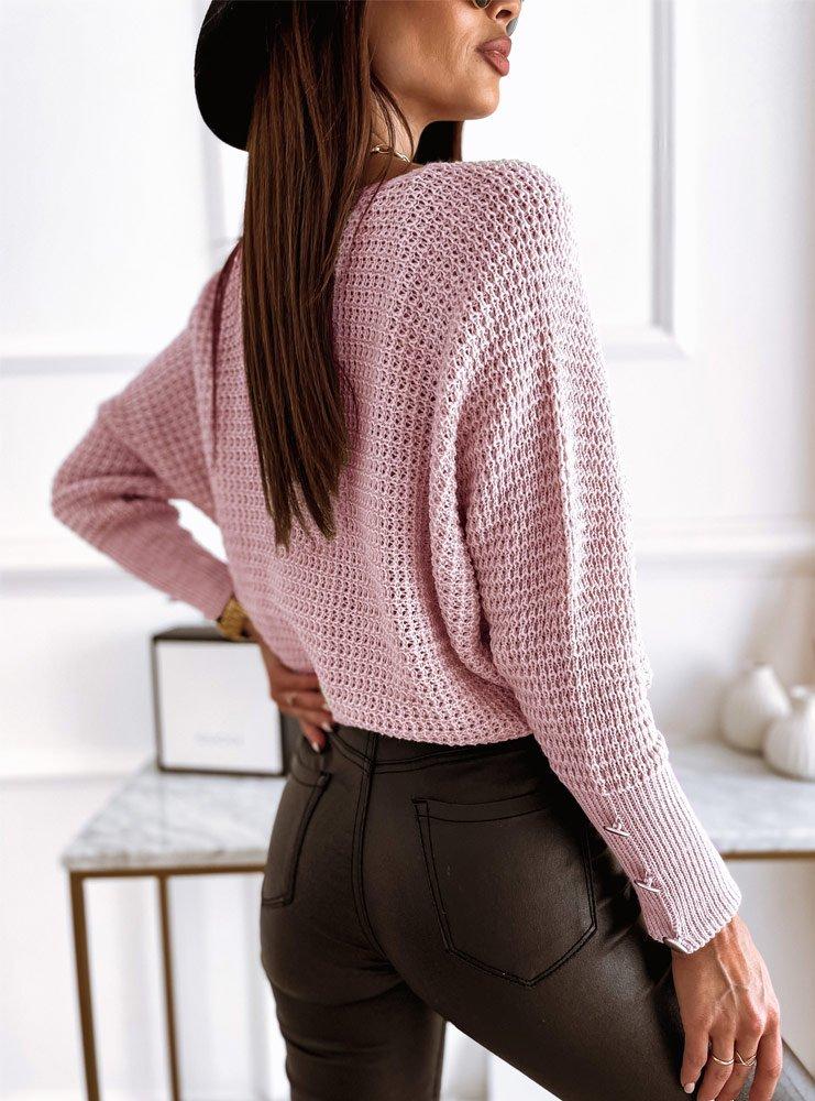 Pudrowy sweterek z ozdobnymi...