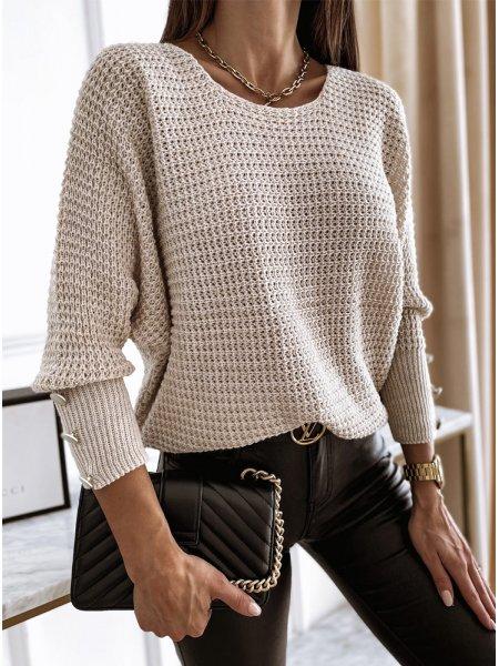 Beżowy sweterek z ozdobnymi...