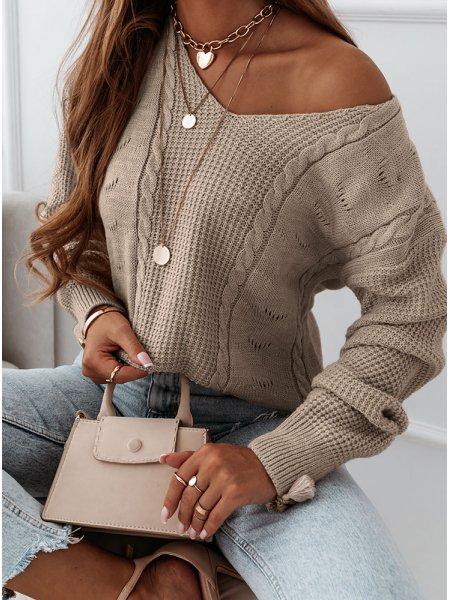 Sweter z dekoltem w serek...