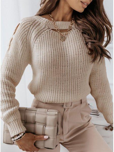 Beżowy sweter z wycięciami...