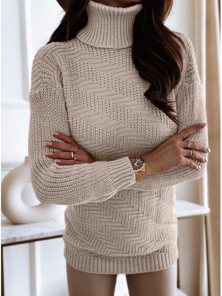 Jasnobeżowy sweterek z...